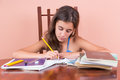 Hispanic girl working on her school homework Royalty Free Stock Photo