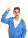 Hispanic guy pointing upwards handsome man in a blue jersey on an isolated white background Stock Photos