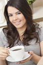 Hispanic Latina Woman Drinking Tea or Coffee Stock Image