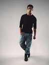 Hispanic male model posing on grey background full length portrait of stylish young man in casuals looking at camera Stock Photos