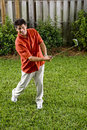 Hispanic man practicing his golf swing Royalty Free Stock Photos