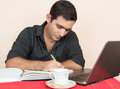 Hispanic man studying or doing office work at home adult education Royalty Free Stock Photo