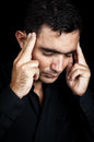 Hispanic man suffering a strong headache Royalty Free Stock Image