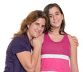 Hispanic mother hugs her teenage daughter isolated on white