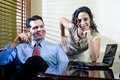 Hispanic office worker working with male colleague Royalty Free Stock Photos