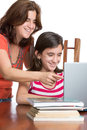 Hispanic teen and her mother browsing the web and laughing on a laptop computer isolated on white Royalty Free Stock Images
