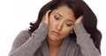 Hispanic woman with anxiety looking down Royalty Free Stock Images