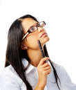 Hispanic woman with glasses thinking with pen Royalty Free Stock Photos