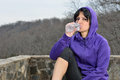 Hispanic woman jogging water break beautiful sitting drinking from bottle and in running attire during fitness routine Royalty Free Stock Image