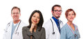 Hispanic Woman with Male and Female Doctors or Nur Royalty Free Stock Photo
