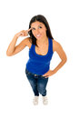 Hispanic woman smiling happy in top and jeans pointing her head thinking Royalty Free Stock Photo