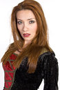 Hispanic woman wearing a costume dress red headed style velvet and staring with serious look toward the camera Royalty Free Stock Photography
