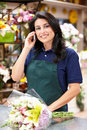 Hispanic woman working in florist Stock Image