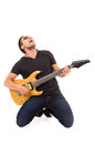 Hispanic young man playing electric guitar Royalty Free Stock Photo