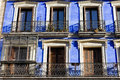 Historic apartment building with balconies blue painted facade in madrid spain Royalty Free Stock Photo