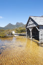 Historic boat shed at cradle mountain tasmania scenic landscape of national park in australia with dove lake and blue sky as copy Stock Photo
