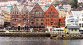 Historic buildings bergen norway colorful old brick line the street running along vagen harbor in the port city of on the Stock Photos
