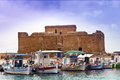 Historic castle in paphos cyprus medieval fort and fishing boats bay Stock Photo