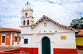 Historic chapel in bogota old white church la candelaria neighborhood of colombia Royalty Free Stock Photo