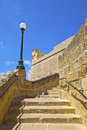 Historic citadel architecture on the island of gozo old narrow steps in victoria malta at area Royalty Free Stock Image