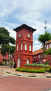 Historic clock tower in melaka the stadthuys an old dutch spelling meaning city hall also known as the red square is a historical Stock Image