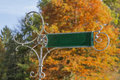 Historic directory sign with orange colored tree druring autumn Royalty Free Stock Images