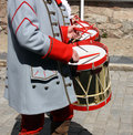 Historic drummers some in old uniforms marching in the street Royalty Free Stock Photo