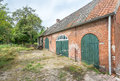 Historic dutch farm from farmyard of an old and weathered in the netherlands Stock Photo