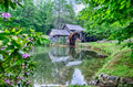 Historic edwin b mabry grist mill mabry mill in rural virgini virginia on blue ridge parkway and reflection on pond summer Stock Photography