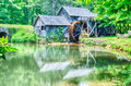 Historic edwin b mabry grist mill mabry mill in rural virgini virginia on blue ridge parkway and reflection on pond summer Stock Photos