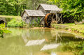 Historic edwin b mabry grist mill mabry mill in rural virgini virginia on blue ridge parkway and reflection on pond summer Stock Photo