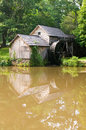 Historic edwin b mabry grist mill mabry mill in rural virginia on blue ridge parkway and reflection on pond in summer Stock Images