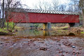 Historic frankenfield covered bridge bucks county scenic tinicum creek flowing under the crossing span in pennsylvania Stock Photos