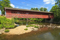 Historic henry covered bridge over walloomsac river e bennington vermont Stock Photo