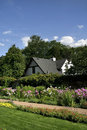 Historic Home And Flower Garden Royalty Free Stock Photo