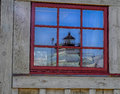 Historic Hooper Strait Lighthouse reflected in Window Royalty Free Stock Photo