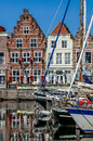Historic houses goes harbour netherlands on turfkade and the of the city of in zeeland the Royalty Free Stock Photo