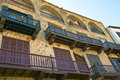 Historic houses at the harbour in kyrenia cyprus with balconies overlooking Stock Photo