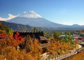 Historic japanese huts in kawaguchi japan with mt fuji visible in the distance Stock Photography