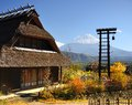 Historic japanese huts in kawaguchi japan with mt fuji visible in the distance Royalty Free Stock Photos