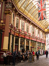 Historic leadenhall market in london people drinking at a pub the the city of england Stock Photo