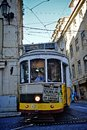 Historic lisbon tram yellow during a turn http www washingtonpost com lifestyle travel falling in love and longing in a c e Royalty Free Stock Photography
