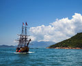 Historic old ship in the ocean near islands and beautiful panorama Royalty Free Stock Images