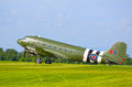 Historic raf dakota wwii aircraft in flight over cosford airbase Royalty Free Stock Photo