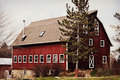 Historic red barn an old in cooksville wisconsin with white windows Stock Images