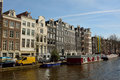 Historic residential buildings along Prinsengracht canal in Amsterdam Royalty Free Stock Photo
