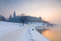 Historic royal wawel castle in cracow poland with frozen vistula river in winter Royalty Free Stock Photo