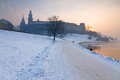Historic royal wawel castle in cracow poland with frozen vistula river in winter Royalty Free Stock Photography