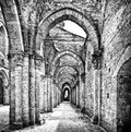Historic ruins of abandoned abbey in black and white Royalty Free Stock Photo