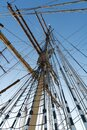 Historic square rig sailing ship rigging from bottom of mast Royalty Free Stock Photo
